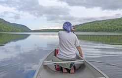 Barefoot Paddler on a Calm Lake Stock Photo