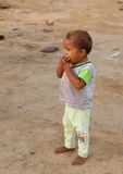Barefoot Papuan kid Stock Photo