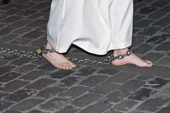 Barefoot penitent. Stock Image