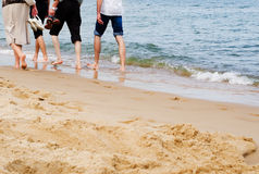 Barefoot people walking on sand beach Royalty Free Stock Photos