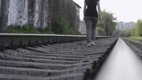 Barefoot by railroad stock video