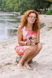 Barefoot red hair woman with snails Royalty Free Stock Photo