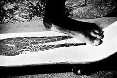 Barefoot ride. Boy's foot on a skateboard Royalty Free Stock Image