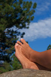 Barefoot on a Rock Stock Photos