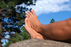 Barefoot on a Rock Stock Photography