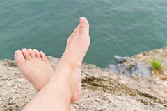 Barefoot on the rock Royalty Free Stock Image