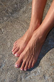 Barefoot on a Rock Stock Images