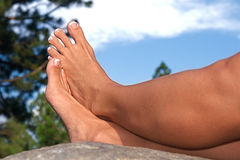 Barefoot on a Rock Stock Photo