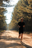 Barefoot runner running through the autumn forest Royalty Free Stock Photo