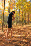 Barefoot runner running through the autumn forest Royalty Free Stock Images