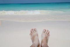Barefoot on sand beach Stock Photos