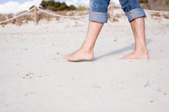 Barefoot in the sand in summer holidays relaxing Royalty Free Stock Photo