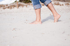 Barefoot in the sand in summer holidays relaxing Royalty Free Stock Images