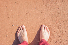 Barefoot on sand Stock Photo