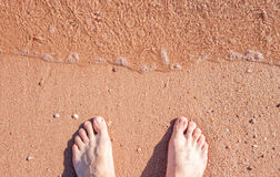 Barefoot on sand Stock Image