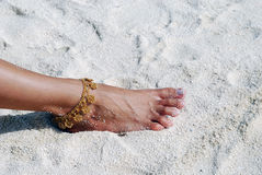 Barefoot on the sandy beach Stock Photography