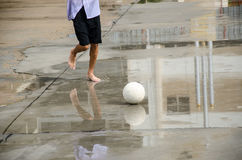 Barefoot soccer Stock Photography