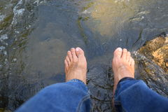 Barefoot of traveller relaxing Stock Images