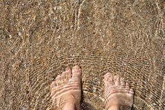Barefoot wade in the Aegean sea. Greece stock photography