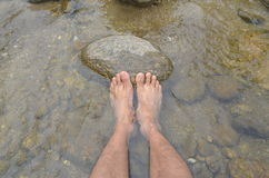 Foot in water. Barefoot in water,krung ching water fall Royalty Free Stock Images