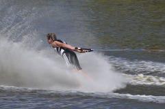 Barefoot Water Skier 01. MS A barefoot water skier skiing backwards at the World Championships royalty free stock photo