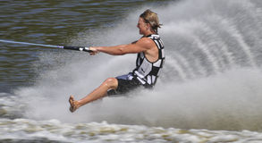 Barefoot Water Skier 02. MS A barefoot water skier skiing one foot forwards at the World Championships Royalty Free Stock Image