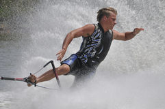 Barefoot Water Skier 07. MW Front to back turn Toehold - A barefoot water skier skiing at the World Championships, USA Team wetsuit Stock Image