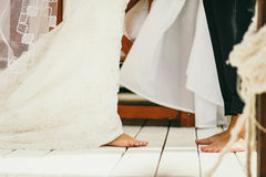 Barefoot Wedding Couple. Happy married couple royalty free stock images