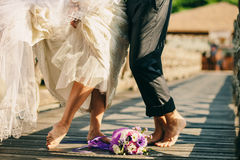 Barefoot Wedding Couple. Happy married couple royalty free stock photography