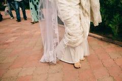 Barefoot Wedding Couple. Happy married couple stock images