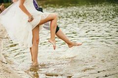 Barefoot Wedding Couple. Happy married couple royalty free stock photo