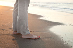 Barefoot woman on the beach Stock Image