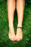 Barefoot woman feet Stock Images