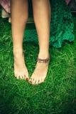 Barefoot woman feet on grass Stock Photo
