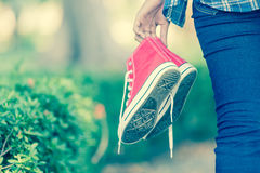 Barefoot woman holding shoes Royalty Free Stock Photos