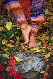 Barefoot woman legs in yoga tree pose in colorful autumn leaves. Outdoor day shot c stock photo