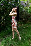 Barefoot woman in the Park. Barefoot woman with long dark hair posing in the Park royalty free stock photos