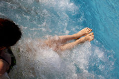 Barefoot woman in the pool of the spa. During a session of massage therapy stock photos