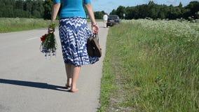 Barefoot woman road