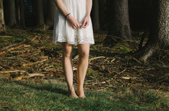 Barefoot woman in scary forest Stock Images