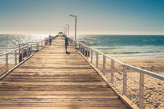Barefoot woman walking along the pier Royalty Free Stock Photography
