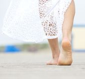 Barefoot woman walking away Stock Photo