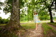Barefoot woman walking in the forest. Portrait of a barefoot woman walking alone in the forest Royalty Free Stock Image