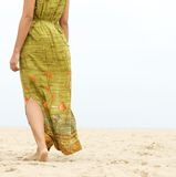 Barefoot woman walking forward at the beach Royalty Free Stock Photos
