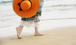 Barefoot woman walking on the ocean beach sand Royalty Free Stock Photos