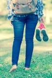 Barefoot woman walking on the pathway Stock Image
