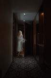 Barefoot Woman with white Bathrobe open the Door Royalty Free Stock Photo