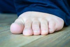 Barefoot on wooden floor royalty free stock photo