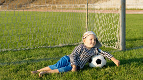 Barefoot youngster with soccer ball Royalty Free Stock Photography