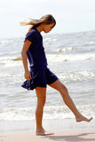 Barefooted. The girl on coast of a gulf Stock Images